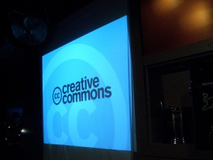 Photo of Creative Commons logo projected on a screen